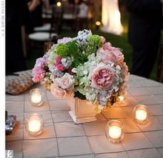 Sara Jane and Jeff used peonies, roses, and hydrangeas in all their flower arrangements. The reception centerpieces also featured small votive candles to add warmth to the tables.