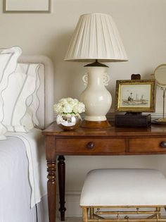 A vignette from Phoebe Howard's own bedroom, in her Atlanta apartment (since sold). She clearly likes the pleated shade on a personal level, using one with a Vaughan lamp.