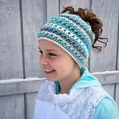 This is a PDF crochet pattern for a beanie with a hole in the top to allow for a ponytail or messy bun. The hole uses an elastic hair tie to stretch over a bun but still stay snug for a ponytail. Keep your hair up and out of the way but still stay warm!