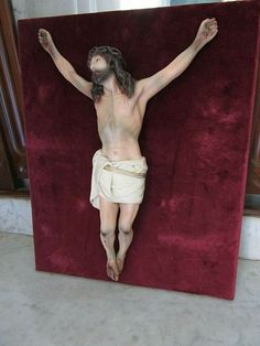 Antique Crucifix with Christ of plaster with glass eyes and mark of Olot. Wooden