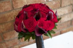 Red rose wedding bouquet with purple calla lilys, so romantic!