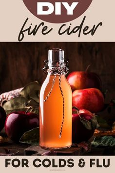 Fire cider vinegar recipe: A natural cold and flu home remedy for symptom relief for a healthy lifestyle. Learn how to make a homemade fire cider vinegar as a natural cold and flu remedy. This traditional, warming apple cider vinegar tonic acts as a holistic decongestant while also supporting immune health. Boost your immunity for health and wellness with this holistic homeopathic fire cider recipe. Holistic home remedy for colds and flu for natural immune support as part of a healthy lifestyle.