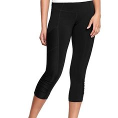 "NWT active capris. NWT never worn! Old navy active capris. 20"" inseam. 85% polyester 15% spandex material. Size is Petite length. These pants do have two pockets on the side panels. Pants Ankle & Cropped"