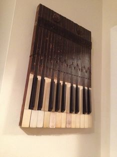 It is inspiring how many parts of the piano can be used outside of the instrument. This is a great key wall decor item.  #upcycling #diy