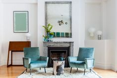 Photo by Alan Gastelum. Interior Design by The New Design Project. Eclectic Design.  Interior Design Inspiration. Eclectic Design. Eclectic Interior Design. Mantle. Fireplace. Living Room. Living Room Inspiration.
