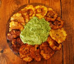 Patacones (fried plantain) with Guacamole - soooo yummy! Pair with Paleo Cuban Pulled Pork