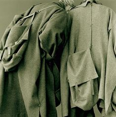 Blended wool coats and integrated bags, Yohji Yamamoto, Autumn/Winter 1983.