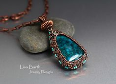 This is a beautiful piece of Chrome Dioptase that I wove a bezel of solid copper and accented with seed beads. --Lisa Barth