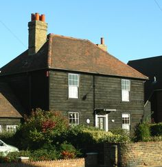 Early 19th century weatherboarded cottages St Mary's Lane Upminster