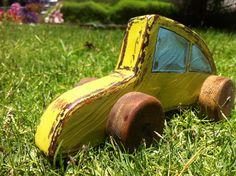 green vintage looking wooden toy Volkswagen Beetle