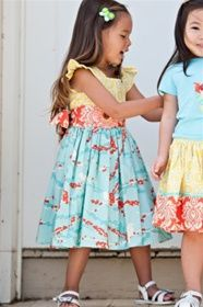 from mylittlejules.com ...cute clothes, but expensive...love the fabrics and colors together...could I sew this?