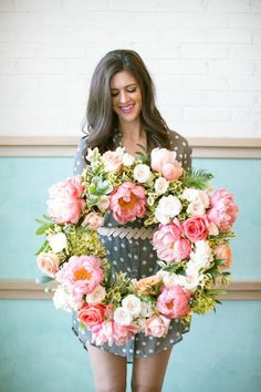 Maxit Flower Design; Flower Wreath, coral peonies, white patience garden roses, blush spray roses.  Garden style