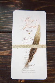 paper goods + feather // photo by Jessica White Photography, styling by Branches Event Floral // http://ruffledblog.com/glittery-thanksgiving-wedding-ideas