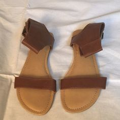 Brown sandals Brown Charlotte Russe Sandals. Has double buckle hardware on the side but Velcro closure. Super cute! Charlotte Russe Shoes Sandals