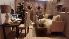 Handmade miniature dollhouse christmas room box all hand made except the laptop and Starbuck's cup. Tree lights up. Sectional sofa, two beaded wreaths, parson chair, desk, wood beam coffee table.