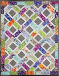 Good Fortune Charm Quilt at Ahhh...Quilting. Made by cutting squares in half and adding solid grey centers and some white.