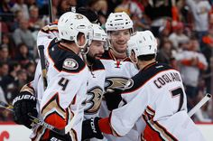 Cam Fowler #4, Ryan Kesler #17, Simon Despres #24 and Andrew Cogliano #7 of the Anaheim Ducks celebrate after Cogliano scored a second period goal against the Arizona Coyotes