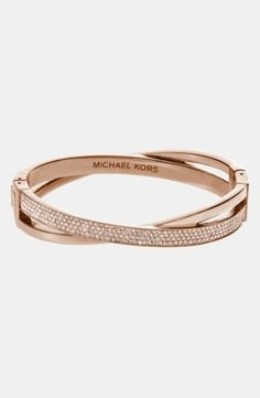 Highly polished and crystal-encrusted intervals define an open crisscross bracelet.Highly polished and crystal-encrusted intervals define an open crisscross bracelet. Color(s): rose gold/ gold quartz. Brand: MICHAEL Michael Kors. Style Name: Michael Kors 'Brilliance' Crisscros... $165.00 by nordstrom