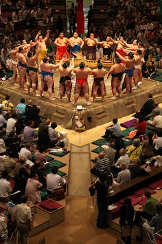 On the day before the beginning of each tournament, the dohyō-matsuri, a ring-blessing ceremony, is performed by sumo officials called gyōji. They are the referees on the dohyō, in their elaborate, colorful costumes based on ceremonial court robes of the Heian period (AD 794 – 1185). Dressed in the white robes of a Shinto priest gyōji purify and bless the dohyō in a solemn ceremony during which salt, kelp, dried squid and chestnuts are buried in the center of the dohyō.