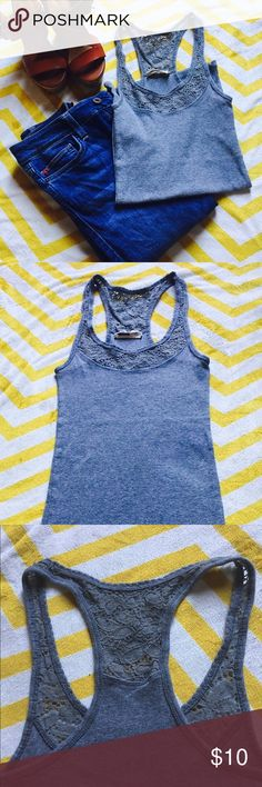 Hollister Ribbed Lace Tank Top Soft, heather grey ribbed tank top with Lace trim. Racer back, longer length, great used condition. Works great under sheer tops and sweaters Hollister Tops Camisoles