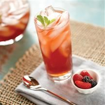 Triple Berry Iced Tea •1 quart cold water (4 cups)  •4 black tea bags  •1/2 cup Smucker's® Special Recipe™ Triple Berry Flavored Topping, or to taste  •Ice cubes  •Mint sprigs for garnish