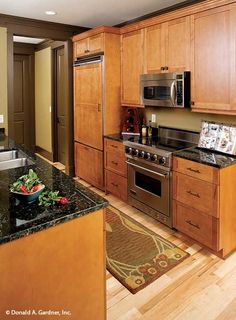 Deep drawers provide convenient storage in this kitchen. The Riva Ridge #5013