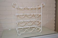 White powdercoat wine rack - holds 12 bottles - very heavy - solid