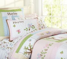 Going to go with this quilt and sham...can give B some pink and keep the blue wall colour in the room!