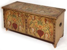 """18th Century New England blanket chest with great tulip decoration over old green paint.  Found in Southern Maine.  25 1/2"""" high x 50"""" long x 20 1/2"""" deep."""