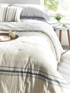 Made from 100% soft cotton with a hand tufted finish, the French Stripe Kingsize Quilt shows a vintage style blue stripe detail and fine striped reverse.