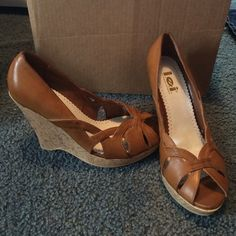 Lei wedges These lei tan wedges have barely been worn and are ready to be worn by you! lei Shoes