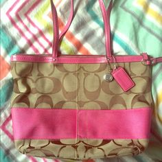 Large coach purse Large coach purse with pink accents. Pink lining. Has a dark stain on the bottom of the lining. Authentic!!! Bags Shoulder Bags