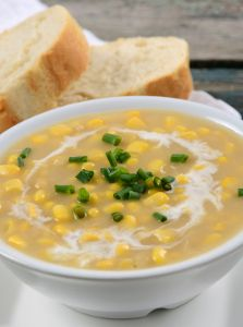 Cheesy Creamed Corn - This slow cooker side dish recipe goes great with a Southern-style meal. It's also a sweet side for a variety of dinners!