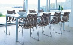 Scandia chairs by Hans Brattrud, manufactured by Fjordfiesta  (Wallpaper Magazine)