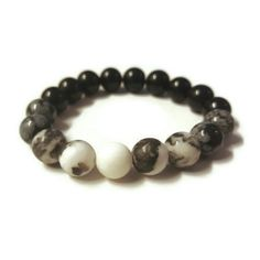 The third ombre beauty - the monochrome Salt and Pepper Bracelet! Obsidian, snowflake obsidian and jaspis zebra in a marvellous combination. Goes perfectly with just about anything.