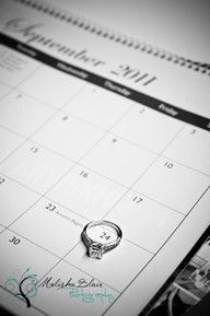 """Sweet 'save the date'. Set your engagement ring on the calendar page that corresponds to the month of your wedding date in a way that the ring """"circles"""" the specific day of the month on which you are to be married."""