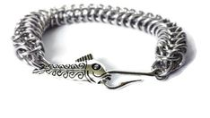 Check out this item in my Etsy shop https://www.etsy.com/listing/241284329/fish-hook-bracelet-chainmaille-bracelet