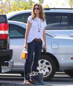 Health kick: Cindy Crawford picked up some fruit juices from a market on Saturday...