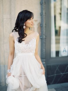 The lovely Bride Wearing Watters - with Illusion sleeveless Neckline + an awesome lace bodice!  See more of the wedding here: http://www.stylemepretty.com/2014/05/15/whimsical-downtown-los-angeles-wedding/  Photography: AshleyKelemen.com