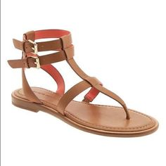 Banana Republic Corie T-Strap Sandal 6.5 in tan For sale these perfect sandals for summer only used once banana republic sandals in color tan but according the banana republic the color is misto with the is due if the straps orange size 6.5 I inly used once and realized I just don't like this style of sandal. The right sandal came as is the stitching that separates the straps became undone. No returns thanks for looking. Banana Republic Shoes Sandals