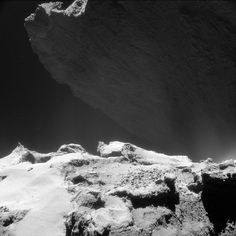 NavCam image of Comet 67P/C-G taken on Oct. 23, 2014 and released on May 5. The image shows a feature of the comet known as the cliffs of Hathor, which are roughly 2,952 feet (900 meters) high. <br />