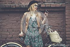 City lifestyle stylish hipster girl with bike using a phone texting on smartphone app in a street Hipster Girls, Texting, Smartphone, Bike, App, Stock Photos, Fresh, Lifestyle, Street