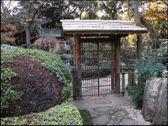 "A simple kido, or gate, leading to the roji-niwa (""dewy ground garden"") of a tea house, New Otani Gardens, Tokyo."