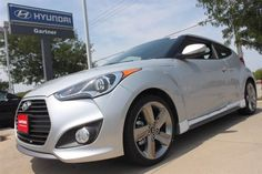 2013 Hyundai Veloster Turbo in Ironman Silver with the Ultimate Package, which includes a Panoramic Sunroof, Navigation System with Back-up Camera and Back-up warning sensors.  Drive something different and unique.  Stop by Napleton's Valley Hyundai in Aurora, IL today for your test drive.