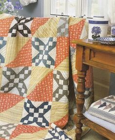 I won this pattern on e-bay.  I cannot wait to see it.  The green and light yellow/gold makes this a cozy quilt.