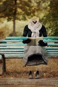 Of course she has a book...  and sets the style with her artfully tied scarf.
