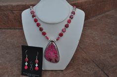 This set is HOT! Imperial jasper dyed pink, with a big hunk set in sterling, with matching beads + white agate too.