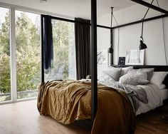 Scandinavian bed with metal bed frame. Click to see