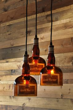Love the look of this - these are made with grand marnier bottles,but growlers would look awesome..I think I'd wrap the top with jute or something similar to hide the tops.  Love the vintage light bulbs.