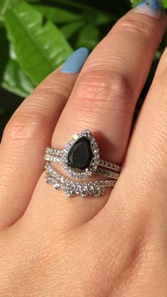 This Pear Cut Black Diamond beauty set in white gold sparkles beautifully paired with a matching Pave Diamond Band and a Crown Diamond Wedding Band ~ black wedding rings Black Diamond Engagement, Morganite Engagement, Gold Engagement Rings, Engagement Ring Settings, Black Wedding Rings, Engagement Jewelry, Halo Engagement, Unique Rings, Beautiful Rings